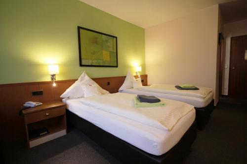 Hotelzimmer Betten